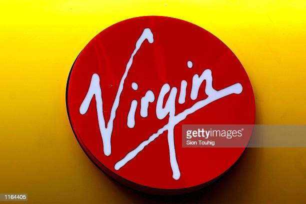 The Virgin logo over the entrance to a Virgin Megastore SEptember 20 2001 on Oxford Street in London The companies airline Virgin Atlantic has cut...