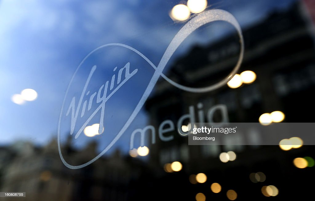 The Virgin Media company sign is displayed on the window of the company's Oxford Street in London, U.K., on Wednesday, Feb. 6, 2013. Billionaire John Malone's Liberty Global Inc. agreed to acquire Virgin Media, Britain's second-largest pay-TV provider, in a $16 billion cash-and-stock transaction announced in the U.S. yesterday. Photographer: Chris Ratcliffe/Bloomberg via Getty Images