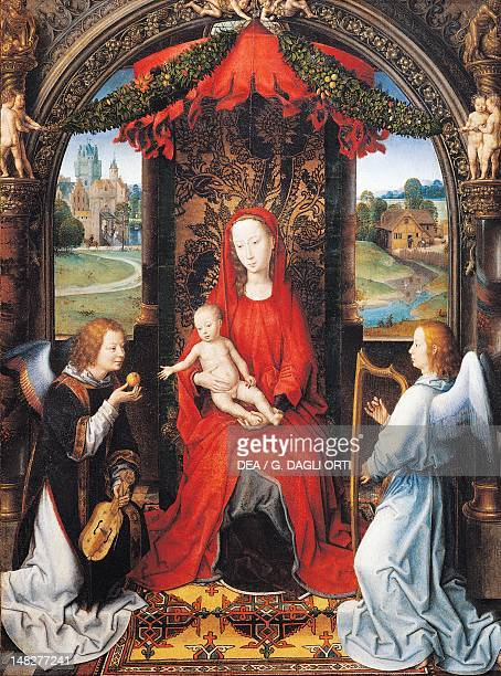 The Virgin with Child and two angels by Hans Memling oil on panel 57x42 cm Florence Galleria Degli Uffizi