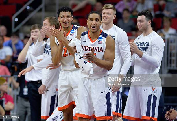 The Virginia Cavaliers bench celebrates in the second half against the Hampton Pirates in the first round of the 2016 NCAA Men's Basketball...