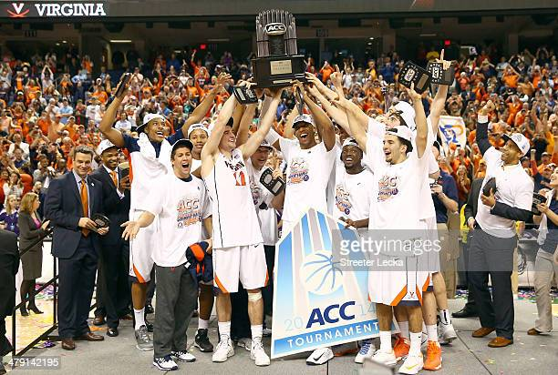 The Virginia Cavaliers celebrate with the trophy after they beat the Duke Blue Devils in the finals of the 2014 Men's ACC Basketball Tournament at...