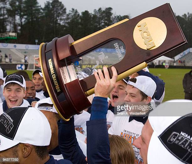 The Virginia Cavaliers hold the National Championship trophy after their win over the Akron Zips at the 2009 Men's College Cup final at WakeMed...