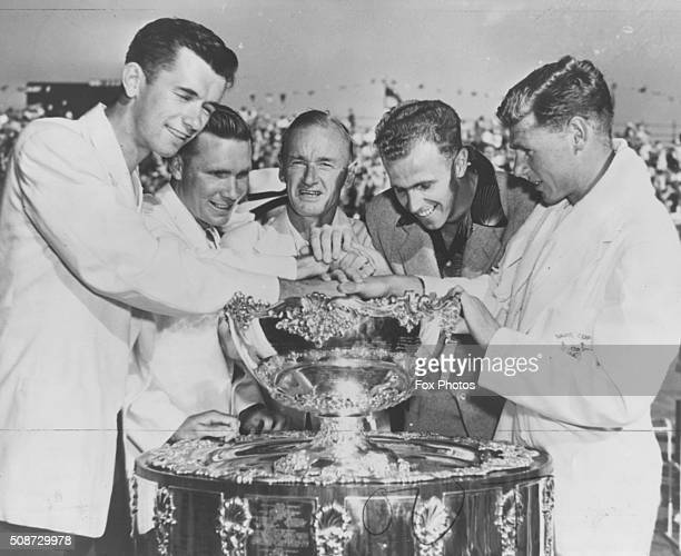 The virtorious Australian Davis Cup team pictured with the trophy following their win over America Mervyn Rose Ian Ayre Harry Hopman Ken McGregor and...