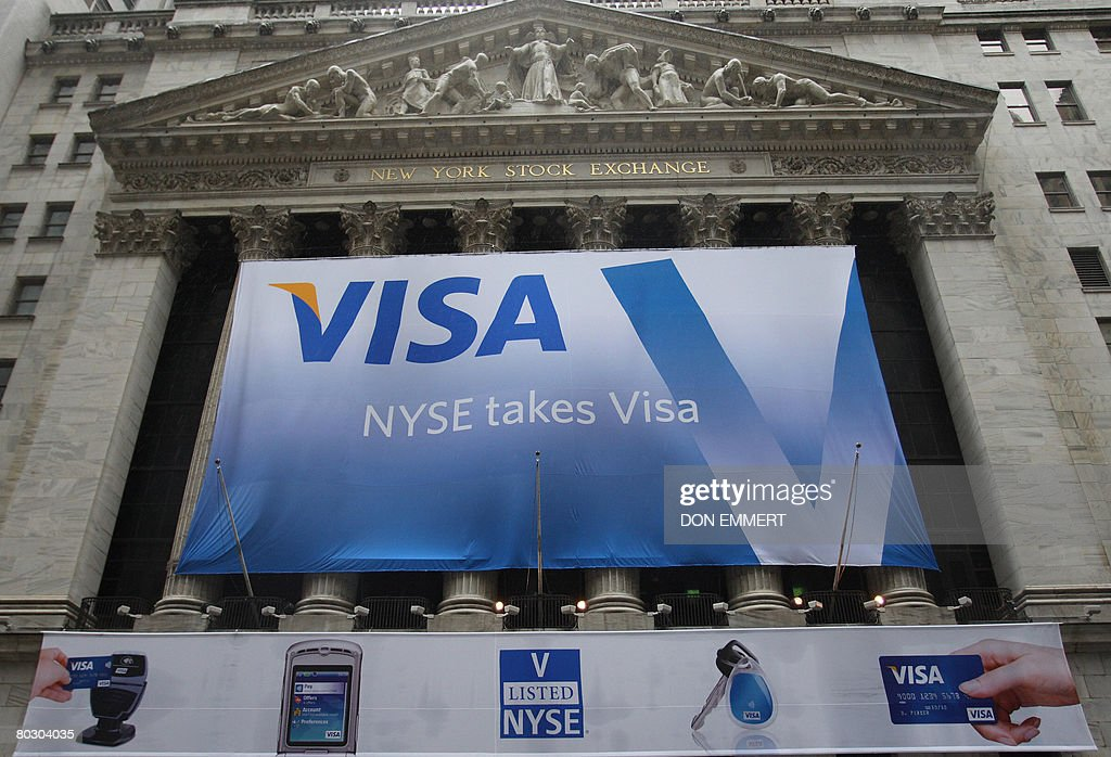 The VISA logo hangs on the front of the New York Stock Exchange on March 19, 2008 in New York. Visa Inc. sold 406,000,000 shares priced at 44 dollars each, raising nearly 17.9 billion dollars before it begins trading on the New York Stock Exchange on Wednesday under the ticker symbol 'V,' the San Francisco-based company said. AFP PHOTO/DON EMMERT