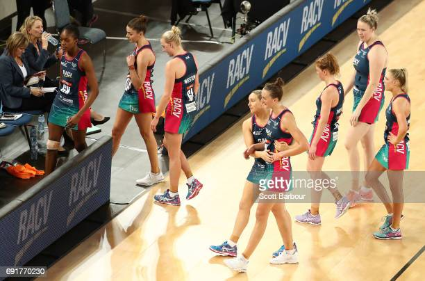The Vixens leave the court after losing the Super Netball Major Semi Final match between the Vixens and the Lightning at Margaret Court Arena on June...