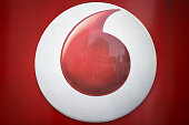 The Vodafone logo is pictured on one of their shops in central London on July 22 2016 British telecoms giant Vodafone reported better than expected...