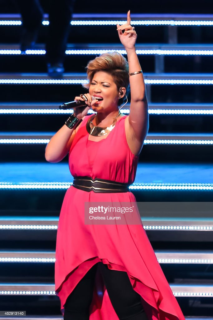 'The Voice' season 5 winner singer Tessanne Chin performs during NBC's 'The Voice' tour at Nokia Theatre LA Live on July 29 2014 in Los Angeles...