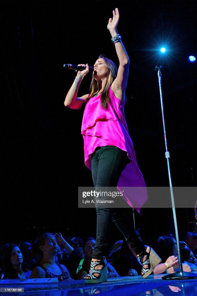 'The Voice' season three winner <a gi-track='captionPersonalityLinkClicked' href=/galleries/search?phrase=Cassadee+Pope&family=editorial&specificpeople=5613333 ng-click='$event.stopPropagation()'>Cassadee Pope</a> performs at First Midwest Bank Amphitheatre on August 17, 2013 in Tinley Park, Illinois.
