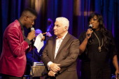 The Voice UK 2014 winner Jermain Jackman Mitch Winehouse and Mica Paris perform together at 'An Evening With Mitch Winehouse' in aid of the Amy...