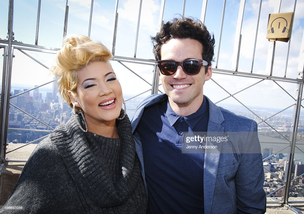 'The Voice' winner Tessanne Chin and 'Pretty Little Liars' star Ian Harding at The Empire State Building on October 8 2014 in New York City