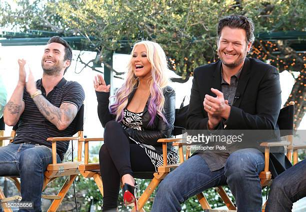 The Voice's Adam Levine Christina Aguilera and Blake Shelton speak onstage during the NBCUniversal's 'The Voice' Press Junket and cocktail reception...