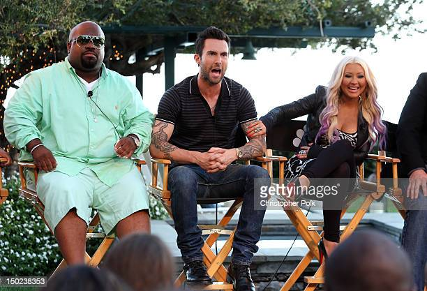 The Voice's Cee Lo Green Adam Levine and Christina Aguilera speak onstage during the NBCUniversal's 'The Voice' Press Junket and cocktail reception...