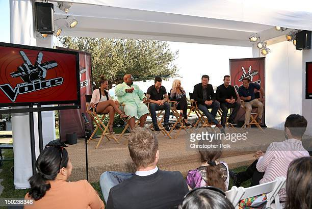 The Voice's Christina Milian Cee Lo Green Adam Levine Christina Aguilera Blake Shelton Carson Daly and Executive producer Mark Burnett speak onstage...