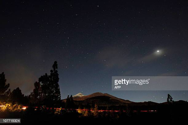 The volcano Teide is pictured on December 21 2010 during a total lunar eclipse in the National Park of Teide on the spanish canary island of Tenerife...