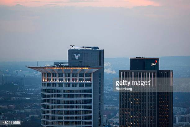 The Volksbank International AG logo sits on the bank's offices left as they stand beside the skyscraper housing offices of Pricewaterhouse Coopers...