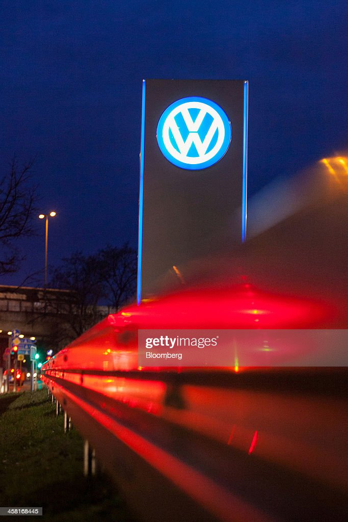 The Volkswagen AG (VW) logo stands illuminated on a sign outside an automobile showroom in Berlin, Germany, on Thursday, Dec. 19, 2013. European new-car sales rose a third consecutive month in November, the longest period of gains in four years. Photographer: Krisztian Bocsi/Bloomberg via Getty Images