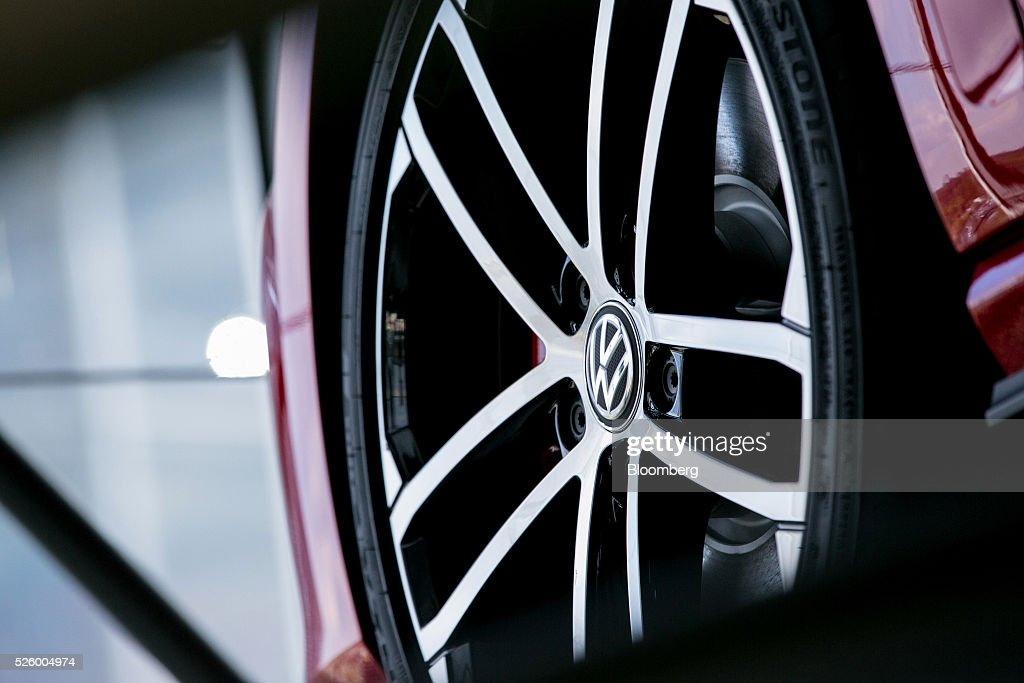The Volkswagen badge (VW) sits the wheel hub of a VW Polo automobile, produced by Volkswagen AG (VW), as it stands inside one of the automaker's glass delivery towers at the VW factory in Wolfsburg, Germany, on Friday, April 29, 2016. Porsche Automobil Holding SE, the investment vehicle of the billionaire family that controls VW, stuck to a goal of making acquisitions beyond the beleaguered carmaker, even as its dwindling cash on hand reduces the scope of possible transactions. Photographer: Krisztian Bocsi/Bloomberg via Getty Images