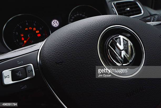 The Volkswagen logo is pictured on the steering wheel of a Polo model car on November 9 2015 in London England Scandinavian Asset Management company...