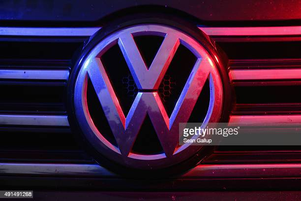 The Volkswagen logo is visible under coloured lights on the front of a Volkswagen Passat 20 turbodiesel passenger car affected by the Volkswagen...