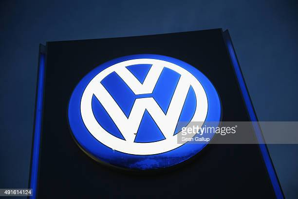 The Volkswagen logo stands illuminated outside a VW dealership at night on October 6 2015 in Berlin Germany Volkswagen has admitted that 8 million...