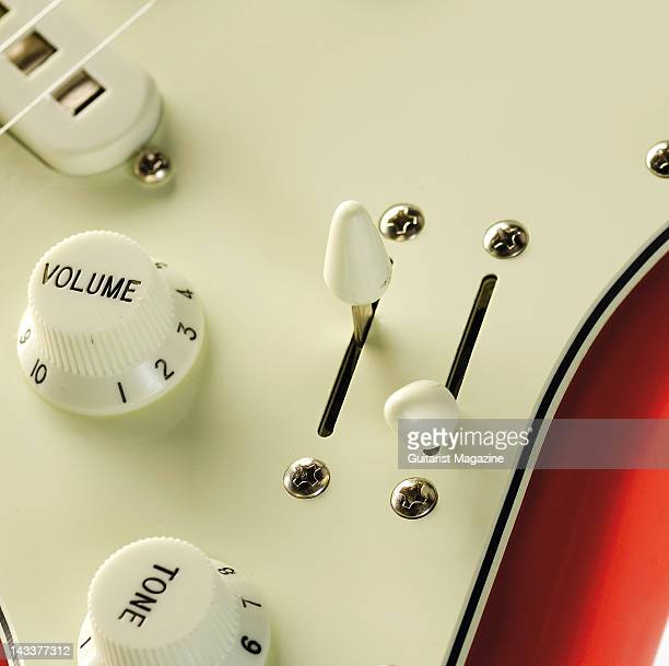 The volume tone and two pickup controls of an Italia Imola Standard electric guitar during a studio shoot for Guitarist Magazine September 14 2007