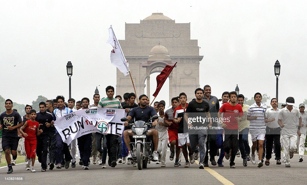 The volunteers for the Run to Vote marathon organized to spread the awareness for the Municipal Corporation of Delhi (MCD) Elections from National Stadium to India Gate on April 13, 2012 in New Delhi, India.