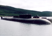The Voronezh one of Russia's largest and most advanced submarines is docked at piers July 26 2003 in the Barents Sea near Vedyaevo Russia A Russian...