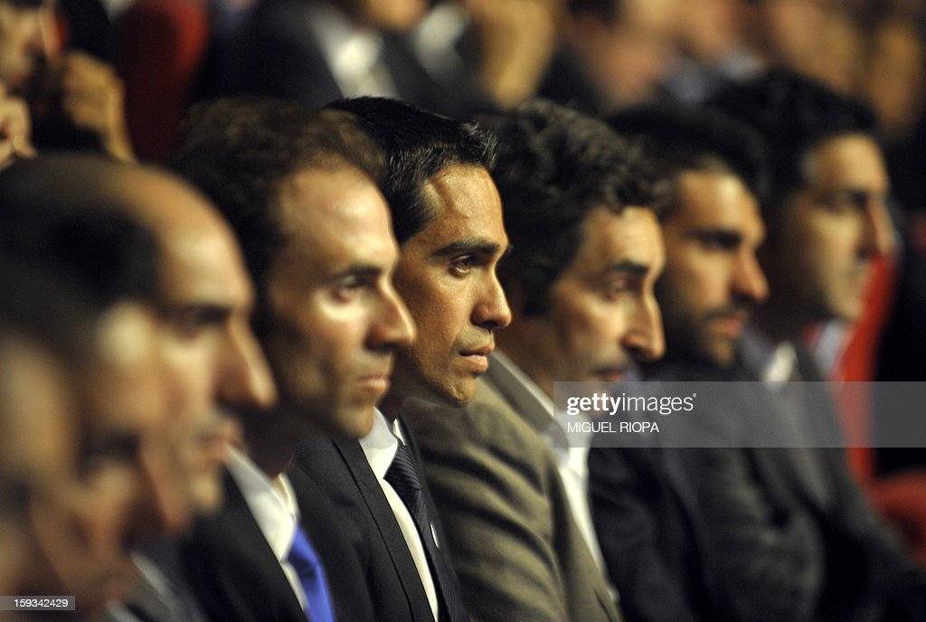 The Vuelta 2012's winner, Spanish cyclist Alberto Contador (4rhL) looks on during the presentation of the 68th Vuelta cycling tour of Spain in Vigo, on January 13, 2013. AFP PHOTO/ MIGUEL RIOPA