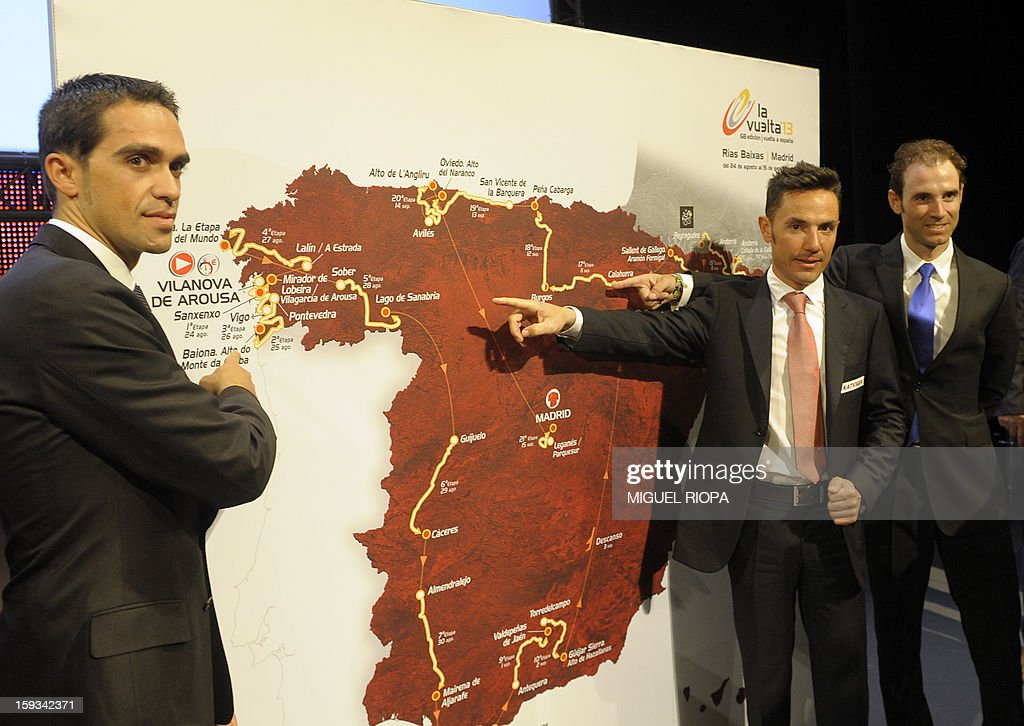 The Vuelta 2012's winner, Spanish cyclist Alberto Contador, Spanish cyclists Joaquin 'Purito' Rodriguez and Alejandro Valverde pose next to the roadmap of the Vuelta 2013 during the presentation of the 68th Vuelta cycling tour of Spain in Vigo, on January 13, 2013.