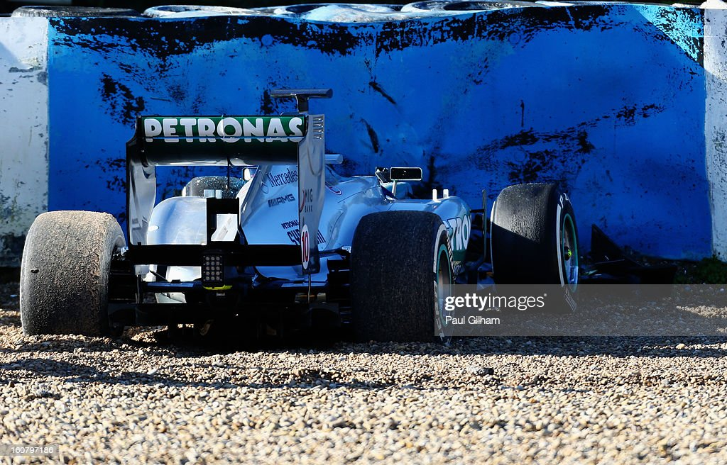 The W04 car belonging to Lewis Hamilton of Great Britain and Mercedes GP sits in the gravel at turn six after crashing during Formula One winter testing at Circuito de Jerez on February 6, 2013 in Jerez de la Frontera, Spain.