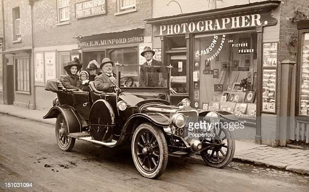 The Wadey family of Adelaide Australia pause to have their photograph taken in Hungerford whilst on a motoring tour of England circa 1912 The Wadeys...