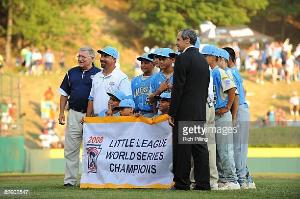 The Waipio Little League team takes a team photo after winning the World Series Championship game against the Matamoros Little League team at Lamade...