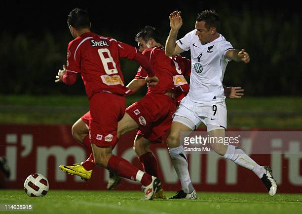 The Waitakere defence holds out Shane Smeltz of the All Whites during the friendly match between the New Zealand All Whites and Waitakere United at...
