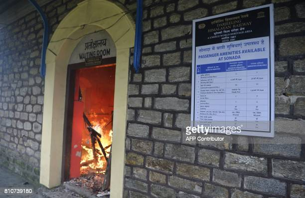 The waitng room of a train station is seen burning during clashes with Gorkhaland supporters during an indefinite strike called Gorkha Janamukti...