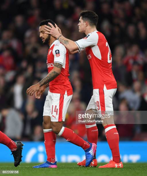 The Walcott celebrate scoring the 1st Arsenal goal with Granit Xhaka during the Emirates FA Cup QuarterFinal between Arsenal and Lincoln City at...