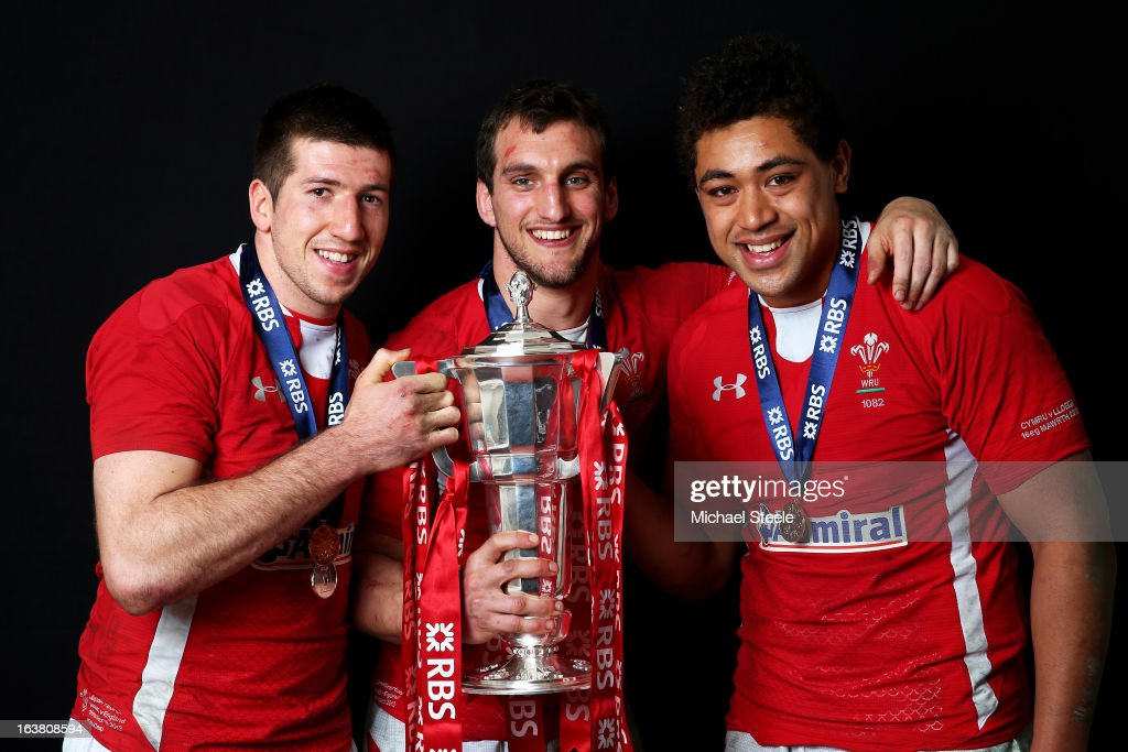 The Wales back row of Justin Tipuric, Sam Warburton and Toby Faletau pose with the Six Nations trophy following his team's victory during the RBS Six Nations match between Wales and England at Millennium Stadium on March 16, 2013 in Cardiff, Wales.
