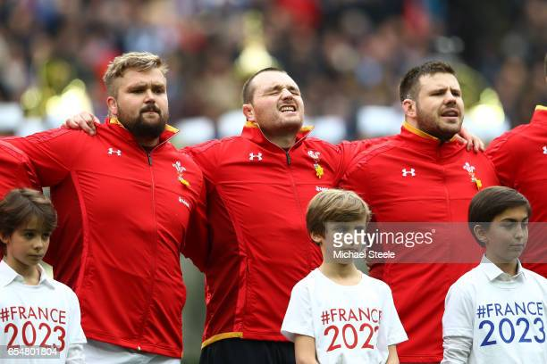 The Wales front row of Tomas Francis Ken Owens and Rob Evans of Wales sing their national anthem prior to kickoff during the RBS Six Nations match...