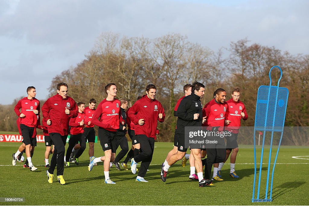 The Wales squad warm up during the Wales training session at Hensol Castle Park on February 4, 2013 in Cardiff, Wales.