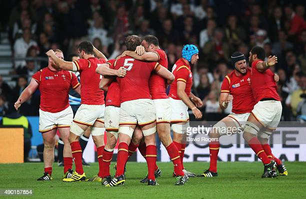 The Wales team celebrate victory on the final whistle during the 2015 Rugby World Cup Pool A match between England and Wales at Twickenham Stadium on...
