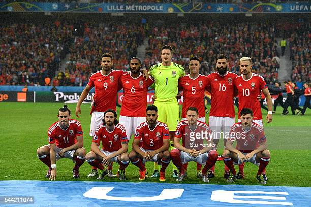 The Wales team line up before the UEFA Euro 2016 Quarter Final match between Wales and Belguim at Stade PierreMauroy on July 1 2016 in Lille France