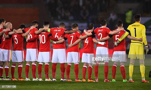 The Wales team line up for a minutes silence in remembrance to the victims of this week's terrorist attacks in Brusselsprior to kickoff during the...