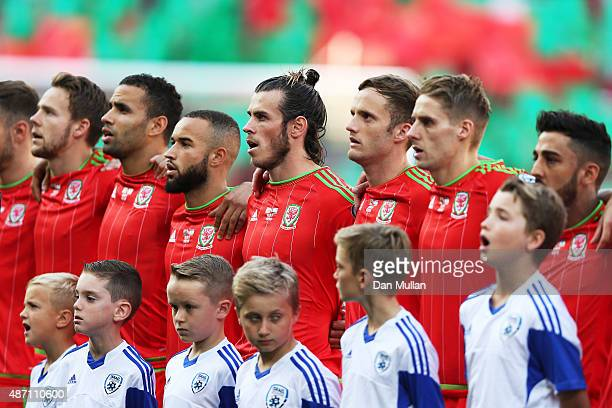 The Wales team sing their national anthem prior to kickoff during the UEFA EURO 2016 group B qualifying match between Wales and Israel at Cardiff...
