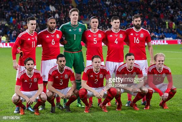 The Wales team Wales's striker Tom Lawrence Wales's defender Ashley Williams Wales's goalkeeper Wayne Hennessey Wales's defender James Chester...