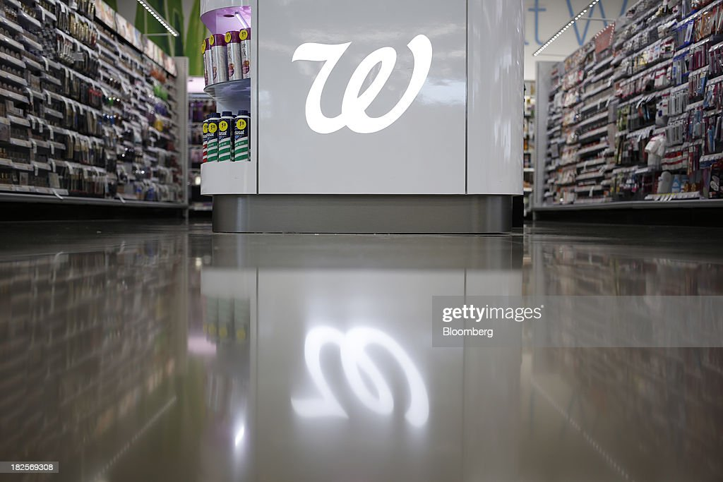 The Walgreen Co. logo is displayed in the cosmetics section of one of the company's stores in Louisville, Kentucky, U.S., on Monday, Sept. 30, 2013. Walgreen Co., the biggest U.S. drugstore chain, is expected to report fourth-quarter earnings before the opening of U.S financial markets on Oct. 1. Photographer: Luke Sharrett/Bloomberg via Getty Images