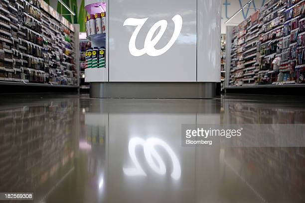 The Walgreen Co logo is displayed in the cosmetics section of one of the company's stores in Louisville Kentucky US on Monday Sept 30 2013 Walgreen...