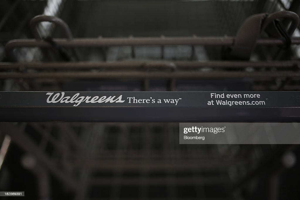 The Walgreen Co. logo is displayed on a shopping cart at one of the company's stores in Louisville, Kentucky, U.S., on Monday, Sept. 30, 2013. Walgreen Co., the biggest U.S. drugstore chain, is expected to report fourth-quarter earnings before the opening of U.S financial markets on Oct. 1. Photographer: Luke Sharrett/Bloomberg via Getty Images