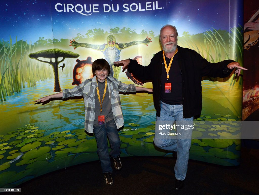 'The Walking Dead' cast members Chandler Riggs and Scott Wilson attend Cirque du Soleil TOTEM Premiere at Atlantic Station on October 26, 2012 in Atlanta, Georgia.