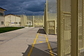The walkway betweens wings at HMP YOI Littlehey Littlehey is a purpose build category C prison