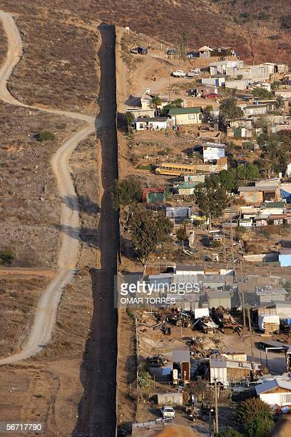 The wall marking the border between the US and Mexico runs across the Mesa de Otay shantytown on the Mexican side in Tijuana Mexico 24 January 2006...