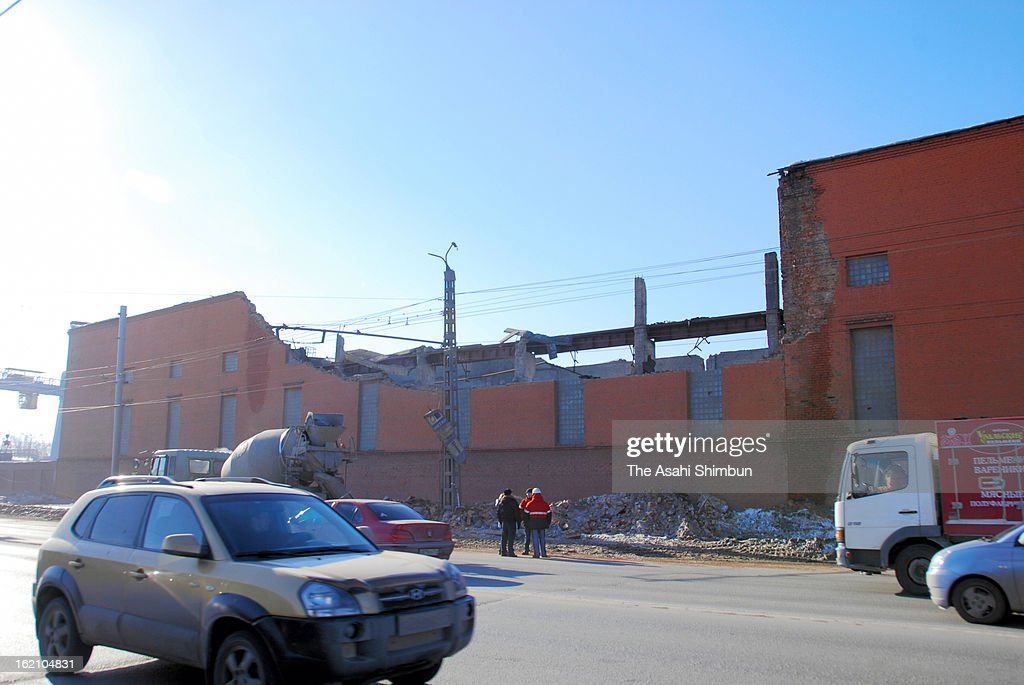 The wall of a zincic factory is blown by the shock wave of the meteor explosion on February 16, 2013 in Chelyabinsk, Russia. Local government reported more than 1,100 people injured, mostly by flying glass broken by the shock wave of the meteor explosion.